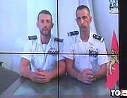 In un frame i due marò italiani, Salvatore Girone e Massimiliano La Torre, In collegamento da Kochi, bloccati da mesi per la vicenda dei pescatori uccisi in India (Ansa)