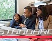 La foto della famiglia di immigrati che compariva sul sito di Trenitalia per illustrare la classe Standard poco più di un mese fa (da www.trenitalia.com)