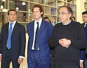 Marchionne con John Elkann (al centro)