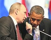 Vladimir Putin parla con Barack Obama (Epa)
