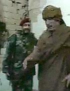 Il leader libico, Muammar Gheddafi, e alle sue spalle il figlio Khamis in un fermo immagine tratto dal video it.euronews.net. del 24 febbraio 2011 (Ansa)