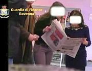 Un video della Guardia di Finanza mostra dei falsi invalidi mentre leggono il giornale (Ansa)