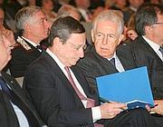 Mario Draghi (a sinistra) e Mario Monti