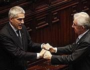 Il leader dell'Udc Pier Ferdinando Casini e il premier Mario Monti in una foto d'archivio (Ansa)