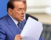 Berlusconi durante il comizio a Brescia (Ansa)