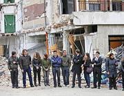 alcuni sopravvissuti davanti alla Casa dello Studente (Ansa/Di Meo)