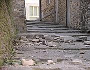 Danni in una strada di Casola (Ansa/Dalle Luche)