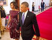 Barack Obama e la moglie Michelle (Afp)