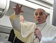 Il Papa in aereo tornando dal Brasile (Ansa)