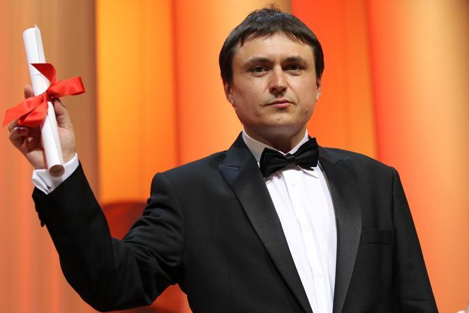 "Il regista romeno Cristian Mungiu che ha vinto il premio per la miglior sceneggiatura con il film ""Beyond the Hills"" (Afp)"
