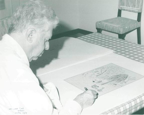 Eugenio Montale intento al disegno. La foto porta firma «Eusebio» e data «Natale 1969» (Fondo Manoscritti di Pavia)