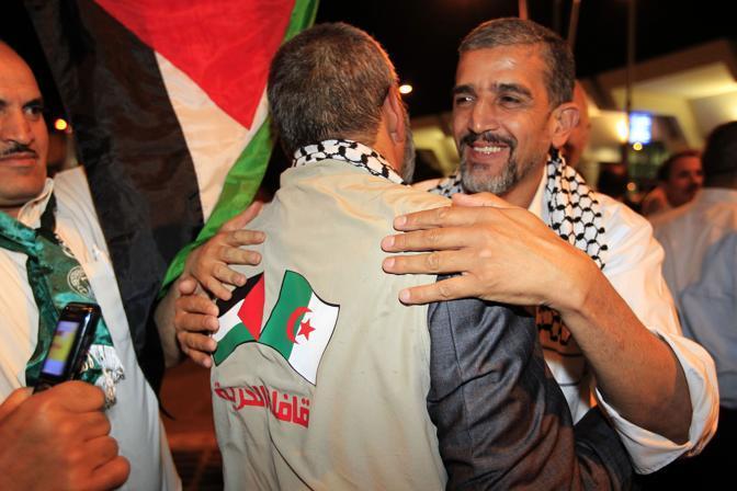 L'arrivo di un attivista ad Algeri (Reuters)