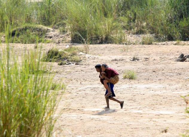 In fuga oltre il fiume Moei (Reuters/Subprasom)