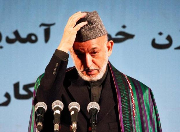 Il presidente afghano, Hamid Karzai, è definito un «paranoico» mentre il fratellastro Hamed Wali Karzai è bollato come «corrotto e trafficante di stupefacenti» (Ap)