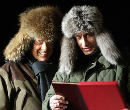 Un'immagine del 3 febbraio 2003 di Putin e Berlusconi (Ansa)