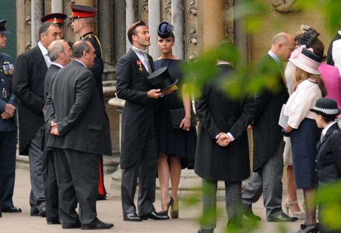 Sono stati tra i primi ad arrivare a Westminster Abbey i coniugi David e Victoria Beckham (Afp)