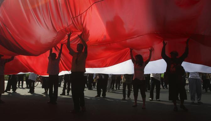 Giakarta, si ricordano le vittime degli attacchi terroristici di dieci anni fa 12 ore prima di New York (Ap)