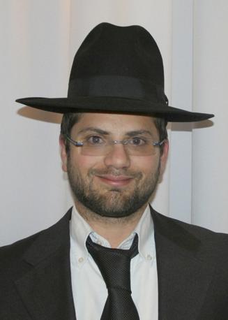 Jonathan Sandler, 30 anni, rabbino e docente di Torah presso la scuola della strage. È morto cercando di proteggere due dei suoi figli (Epa/Aaron Katz)