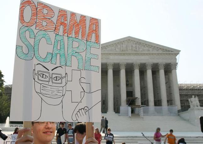 Gioco di parole tra obamacare, obama/sanità e Obama Scare, il terrore di Obama (Afp)