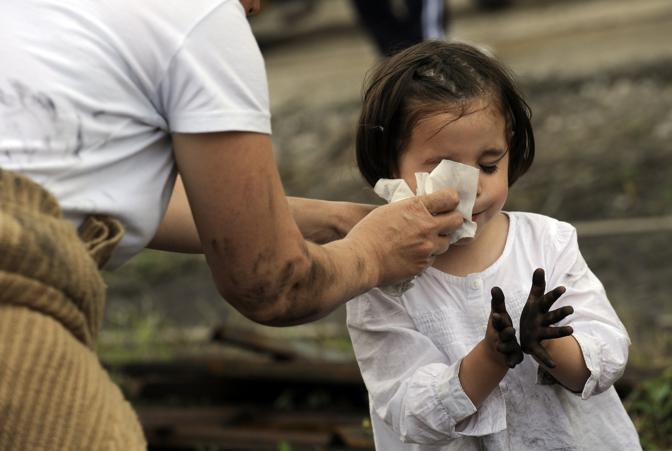 Una bambina di minatori alla protesta (Reuters/Alonso)