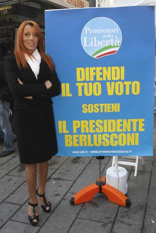 Michela Vittoria Brambilla, ministro del Turismo,  di fronte al gazebo del Popolo della liberta per la mobilitazione nazionale dei «promotori della liberta - difendi il tuo voto sostieni il presidente Berlusconi», a Milano il 4 dicembre 2010 (NewPress)