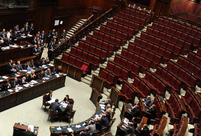 L'aula della Camera semi vuota. Manca l'opposizione che ha disertato la seduta (Ansa)