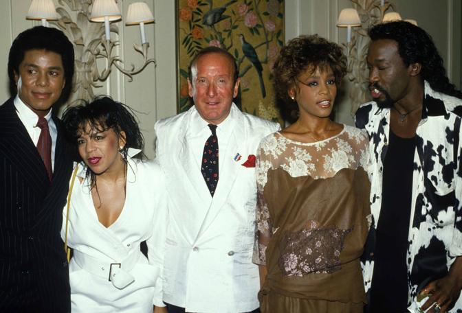 Negli anni 80 con Clive Dives (al centro con la giacca bianca) (Photomasi)