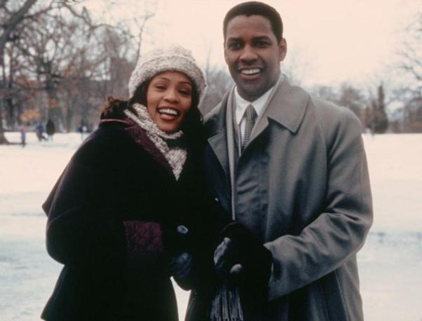 Con Denzel Washington nel 1999 (LaPresse)