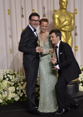 Da sinistra, il regista Hazanavicius, l'attrice  Bejo e il produttore Langmann di «The Artist» (Afp)