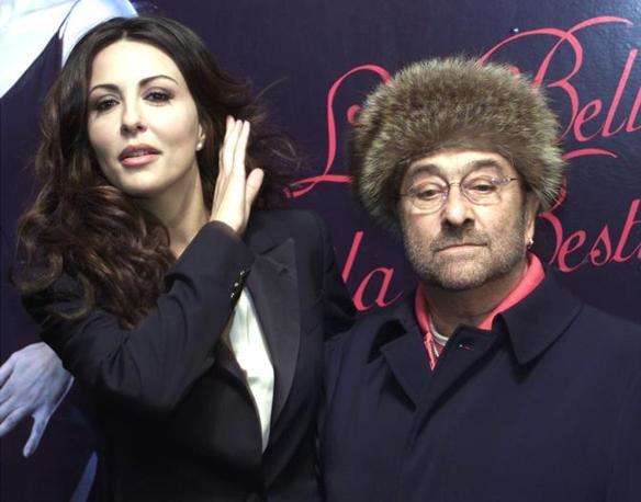 Con Sabrina Ferilli: insieme i due hanno condotto La bella e la bestia nel 2002  su Rai1