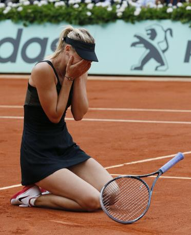 Pianto e gioia per Maria Sharapova (AFP PHOTO / PATRICK KOVARIK) 
