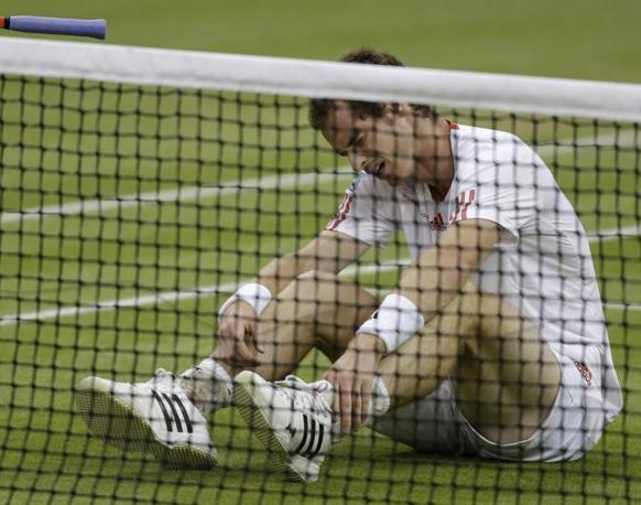 Un piccolo doloretto all'altezza della caviglia per Murray dopo uno scambio sotto rete