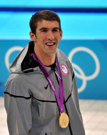 Oro storico: Michael Phelps re delle Olimpiadi moderne. Vincendo i 200 misti è il primo atleta in campo maschile a vincere tre ori in altrettante edizioni nella stessa specialità (Ansa)