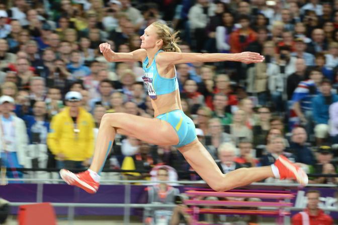 Primi allori per l'atletica: la kazaka Olga Ripakova si aggiudica il salto triplo (Afp)