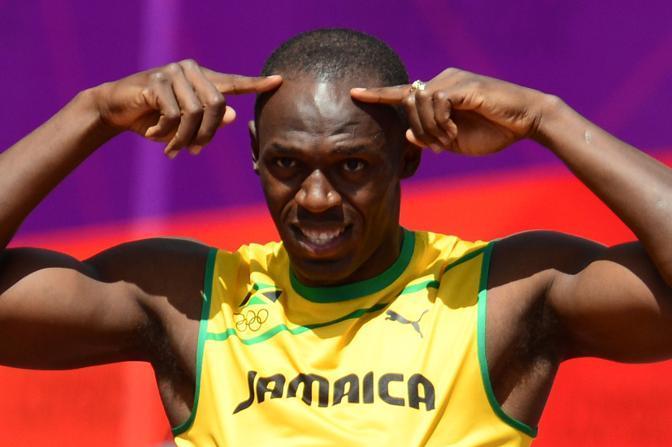 Usain Bolt alla partenza della batteria dei 100 metri allo stadio Olimpico di Londra (Afp/Fife)