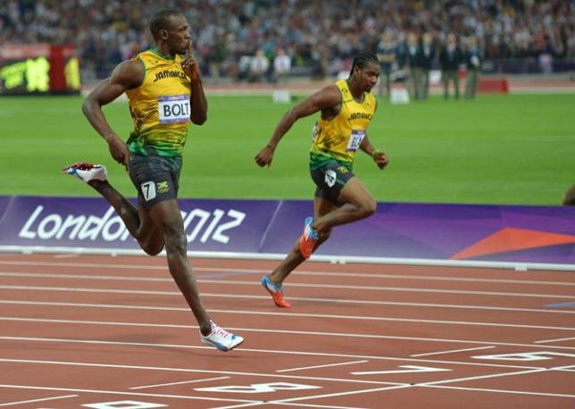 Usain Bolt si ripete: primo olimpionico ad aver rivinto cento e duecento. Sulla seconda misura regina dell'atletica, ha riportato un fenomenale 19.32. Per un podio tutto giamaicano: secondo è Blake e terzo Weir (Afp)