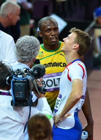 Bolt con il francese Christophe Lemaitre (Afp/Bouys)