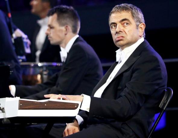 L'attore Rowan Atkinson, conosciuto per il suo ruolo di mr Bean, alla cerimonia inaugurale (Reuters)