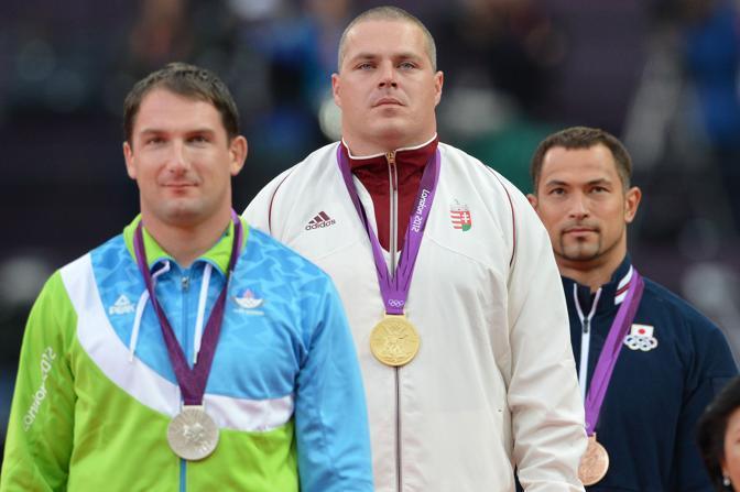 Il podio del lancio del martello: il vincitore è  l'ungherese, Krisztian Pars che si è  imposto con la misura di 80,59. Argento a Primoz Kozmus, oro a Pechino 2008, in 79,36 (Afp/Samad)