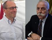 A sinistra Ugo Rossi,  sostenuto dal centrosinistra; a destra l'autonomista Diego Mosna