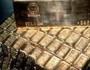 Un'immagine d' archivio di alcuni lingotti d' oro fusi con il marchio della Swiss Central Bank