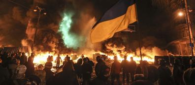 Un momento delle proteste della notte a Kiev (Reuters/Ogirenko)