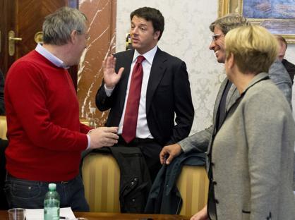 Il leader della Fiom Landini e il premier Renzi (Imagoeconomica)