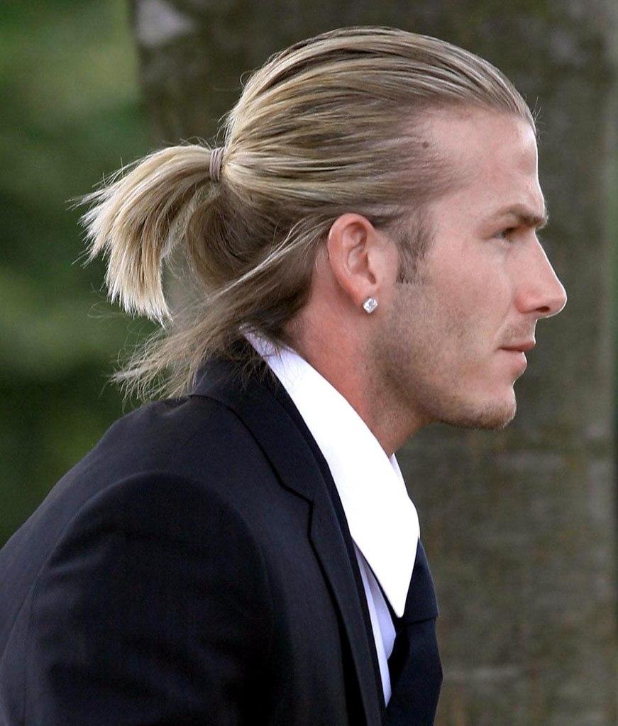 Taglio capelli uomo con codino
