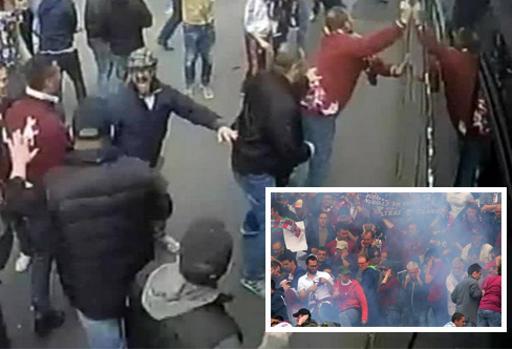 L'assalto degli ultr� granata al pullman della Juventus e i petardi in curva (Ansa)