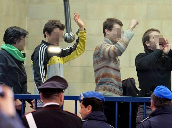 Gli imputati esultano al termine della lettura della sentenza di primo grado a Torinoil ,17 Dicembre 2014 (Ansa/Di Marco)