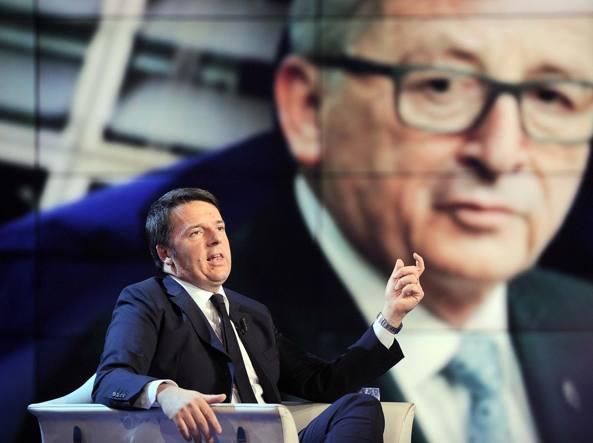Il presidente del Consiglio, Matteo Renzi, e sullo sfondo il presidente Ue, Jean Claude Juncker