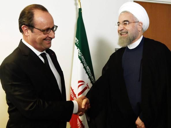 Il presidente francese François Hollande e quello iraniano Hassan Rouhani (Epa)