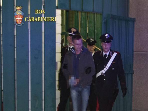 Massimo Carminati dopo l'arresto nel dicembre 2014 (Epa)