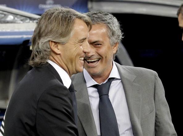 Macini e Mourinho in una sfida di Champions del 2012 (Epa)